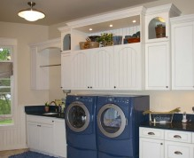 A raised front loading washer and dryer makes doing laundry easier.