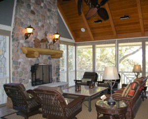 The fireplace in the screen porch is a focal point and adds cozy warmth.