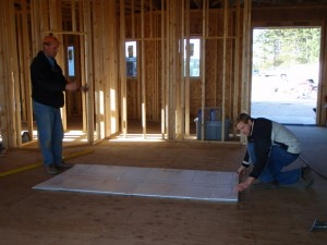 Robert Thelen, job superintendent, and Randy Thelen, owner reviewing a layout on a job.